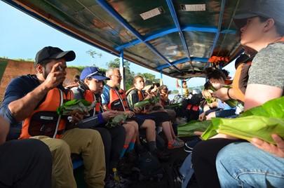 company retreat on a jungle river canoe ride